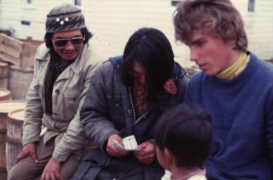 George Haye of Nain (centre) receives a cheque from Erik Sheer (at right).  George Haye and Paul Nochasak brought the expedition to its base camp by boat.